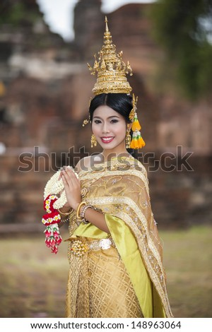 Female in Thailand traditional dress at Ayuthaya historical park - stock photo