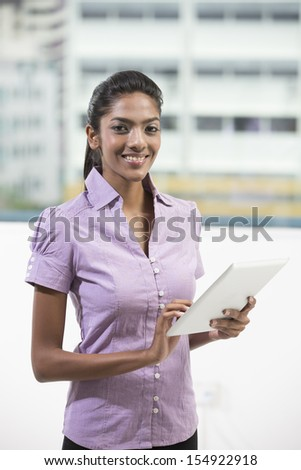 female Indian business woman using a digital tablet
