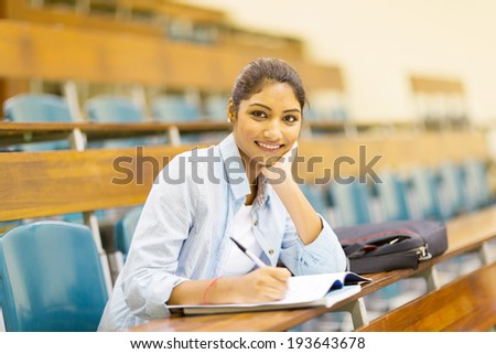 female indian college student in lecture hall - stock photo