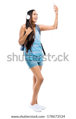 Female Indian student woman video messaging mobile phone - stock photo