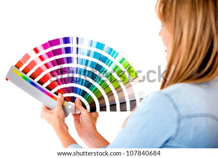 Female interior designer holding color guide - isolated over a white background