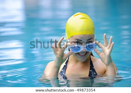 Female is smiling as she gets ready to swim - stock photo