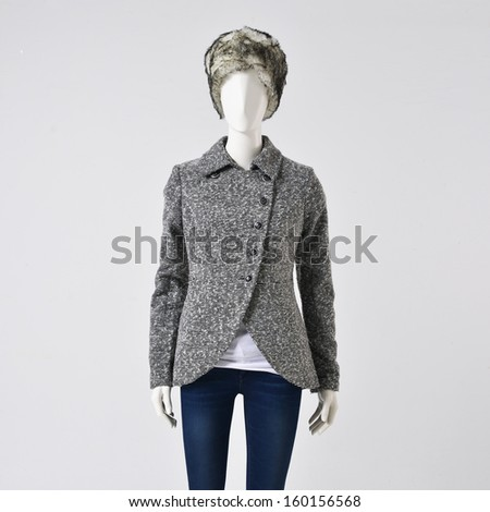 female jacket dress and trousers on mannequin-gray background  - stock photo
