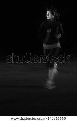 Female Jogger at Night  - stock photo