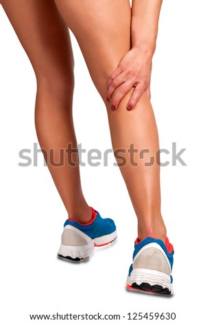 Female jogger with pain in her lower leg, isolated in white - stock photo
