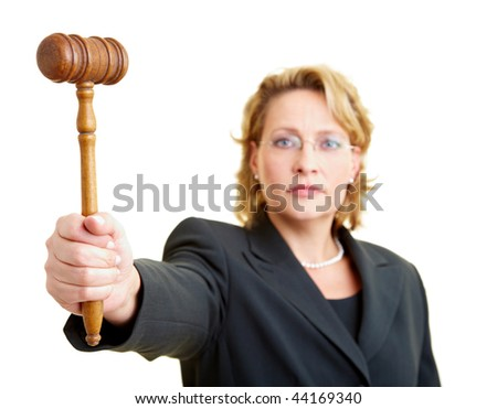 Female judge in jacket holding wooden hammer - stock photo