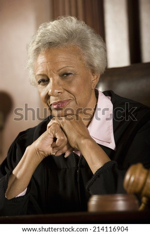Female judge sitting in court, portrait - stock photo