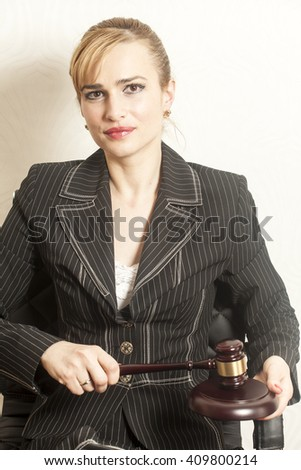 Female Judge With Wooden Gavel  - stock photo