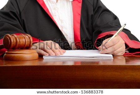 Female judge writing the verdict isolated on white background - stock photo