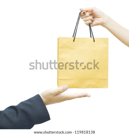 Female keep a brown paper  bag for businessman hand - stock photo