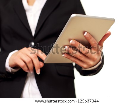 Female keeping her self up-to-date by checking her digital tablet touchpad. Isolated on white background. - stock photo
