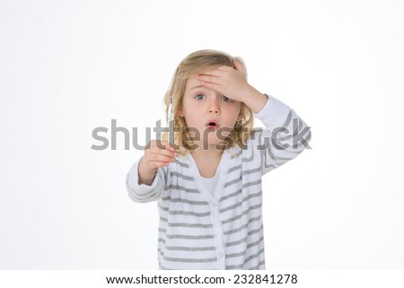 female kid surprised by her own body heat - stock photo