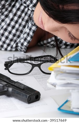 Female killed her self while filling out tax forms while sitting at her desk. Isolated - stock photo