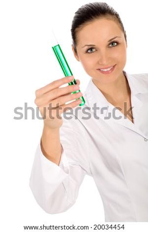 Female lab worker holding up test tube - stock photo