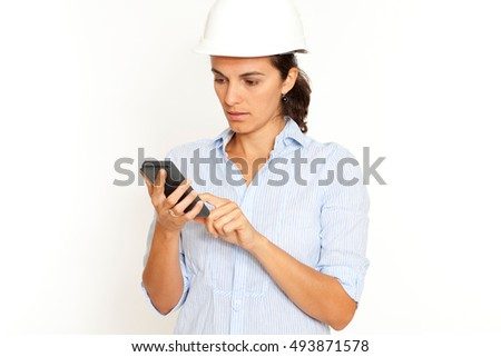 Female latin engineer making some calculations