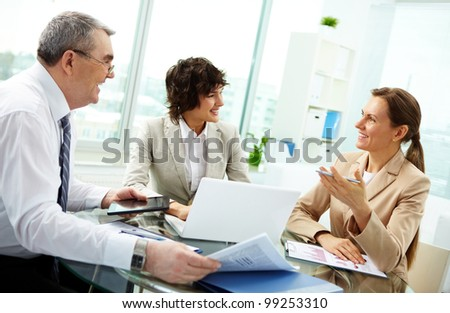 Female leader talking to her workgroup about a new profitable idea