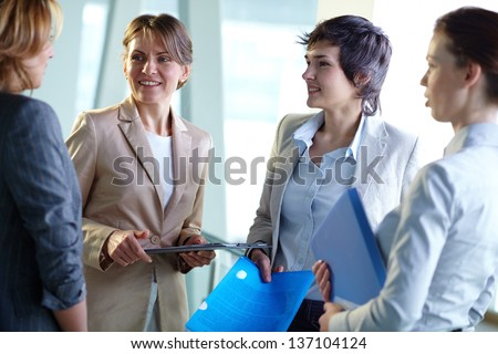 Female leaders speaking about the results of the work - stock photo