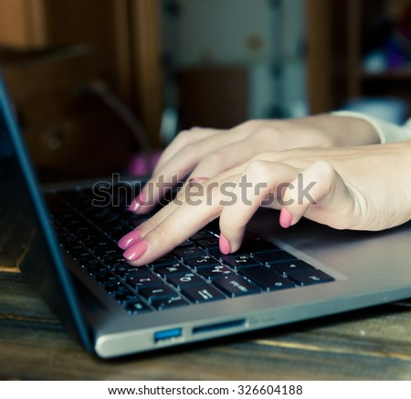 female learner typing on the laptop keyboard - stock photo