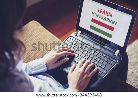 Female learning hungarian at home with a laptop computer at home. - stock photo