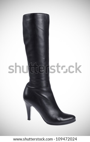 Female leather boot with high heel isolated on white - stock photo
