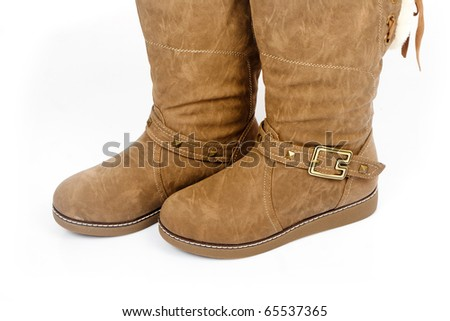 Female leather boots isolated on white