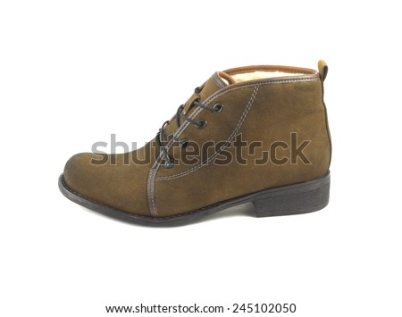 Female left brown warm suede boot isolated on white. Side view closeup