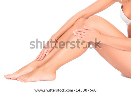 Female legs and hands, white background  - stock photo