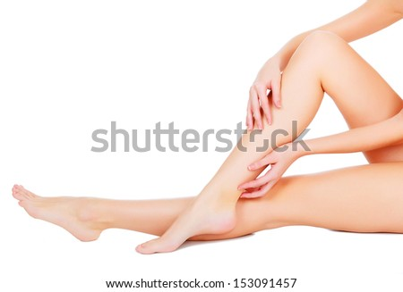 Female legs and hands, white background