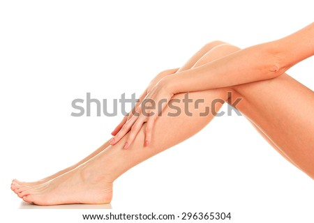 Female legs and hands, white background, isolated - stock photo