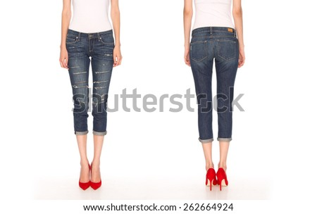 female legs in blue breeches and red shoes - stock photo