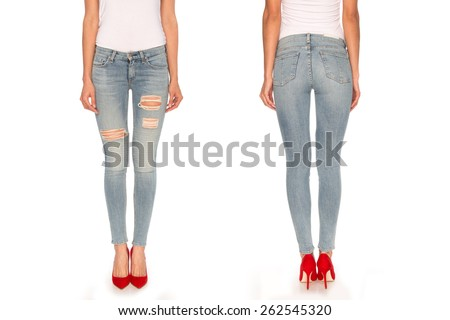 female legs in blue jeans and red shoes - stock photo