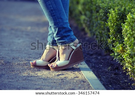 Female Legs in Fashion Shoes. Isolated on a Colorful Background. Close up of Stylish Female Shoes. Outdoor Fashion Shoes Footwear Concept.