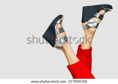 female legs in glitter shoes - stock photo