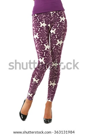 female legs in leggings - stock photo