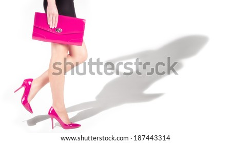Female legs in pink shoes, the shadow of the model