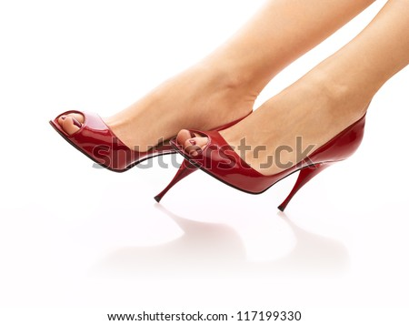 Female legs in red peep toes over isolated white background - stock photo