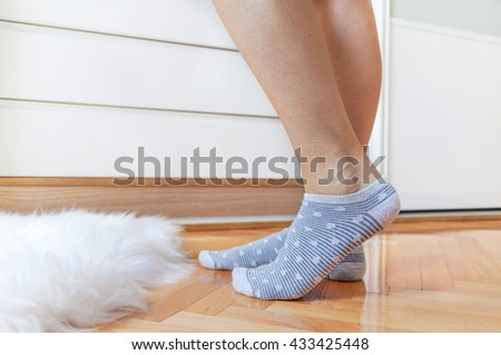 Female legs in striped socks