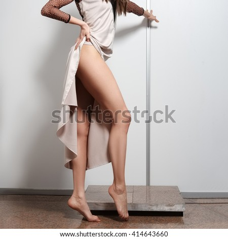 Model Woman Lifting Up Her Dress  Stock Photo  Sucher 4714718