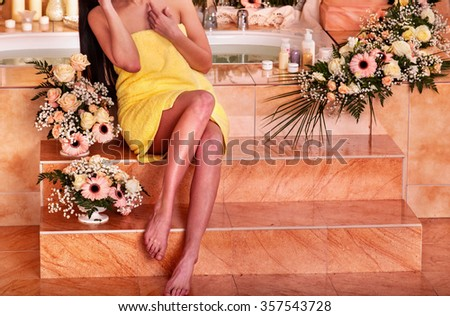 Female legs of woman relaxing at water spa. - stock photo