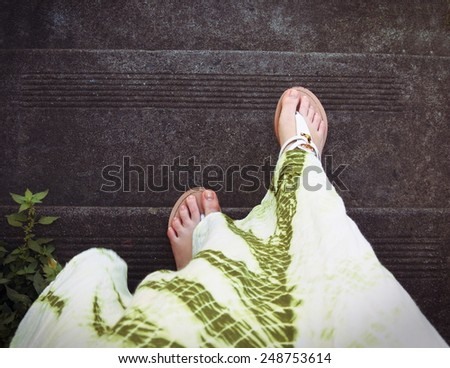 female legs top view on stairs - stock photo