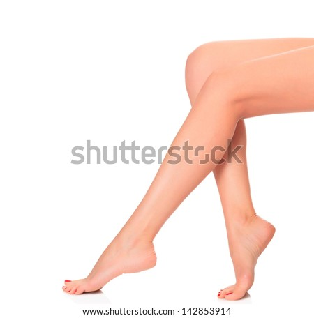Female legs, white background, copyspace