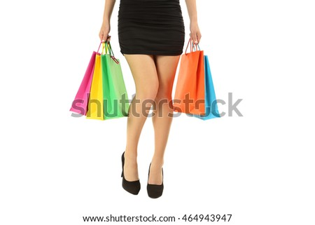 Female legs with black high heels and shopping bags on a white background