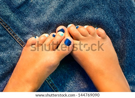 Female legs with the color pedicure - stock photo