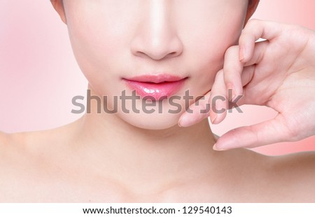 Female lips closeup. Beautiful smile of young fresh woman.  Isolated over pink background. asian model