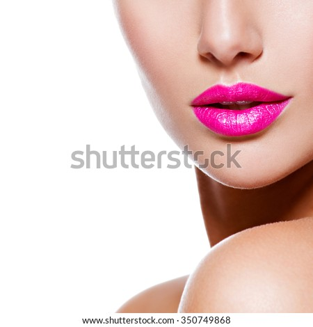 Female lips with pink lipstick and golden veil on the neck. closeup.  - stock photo