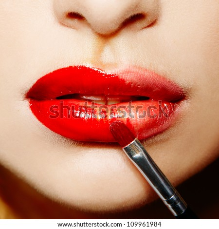 female lips with red lipstick makeup closeup - stock photo