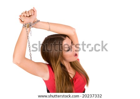 Female locked by metal chain with pain countenance. - stock photo