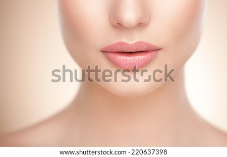 Female lower face and neck. Cropped. - stock photo