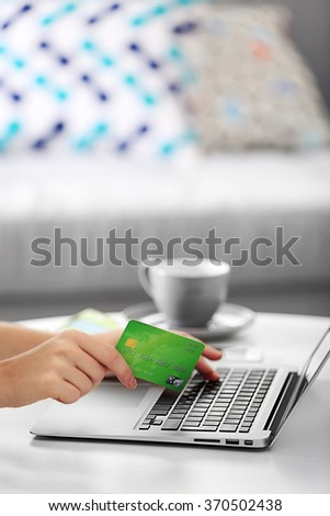 Female making online payment, close up - stock photo