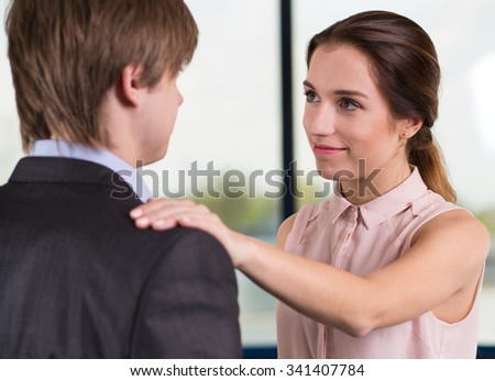 Female manager satisfied with the work of the new employee